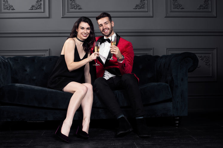 Champagne Cheers With Well-Dressed Couple