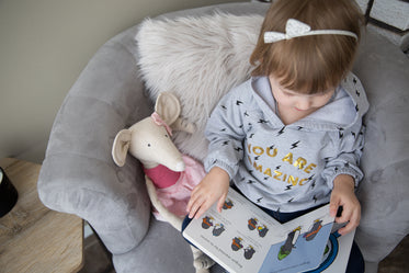 checking out pictures in a book