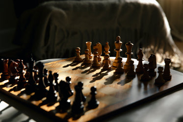 chess board bathed in light creating shadows