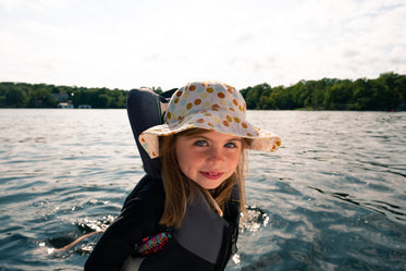 child in life jacket on boat