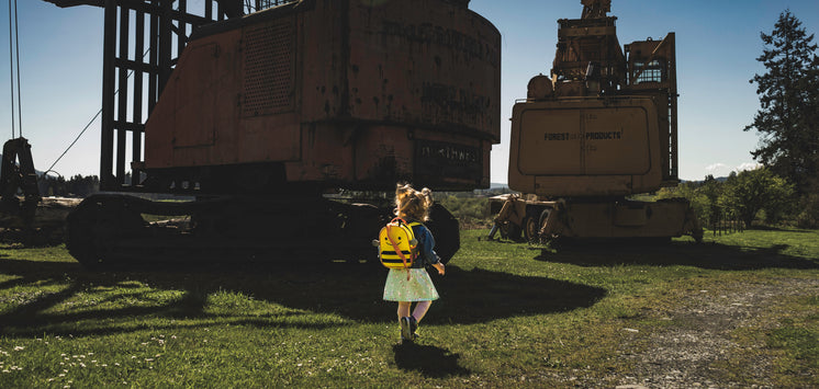 Child Walks Surrounded By Machinery