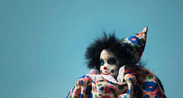childs toy clown on blue