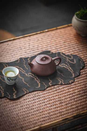 chinese tea set on bamboo table