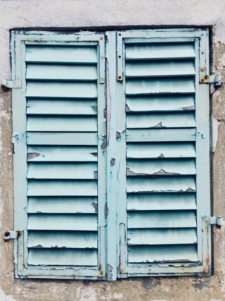 Chipped Blue Paint On Aging Shutters