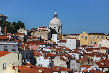 church spire over lisbon rooftops