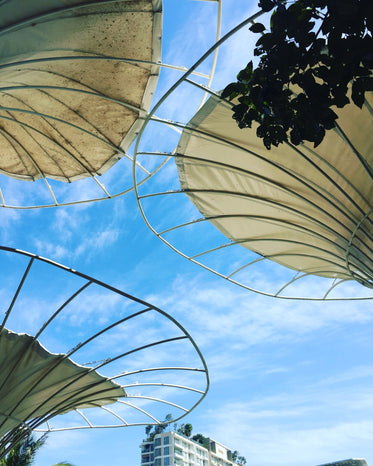 circular metal structure against a blue sky
