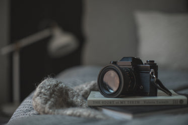 classic camera resting on book