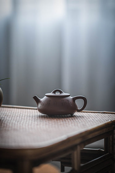 clay teapot on the table