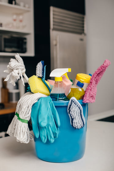 cleaning supply bucket in kitchen