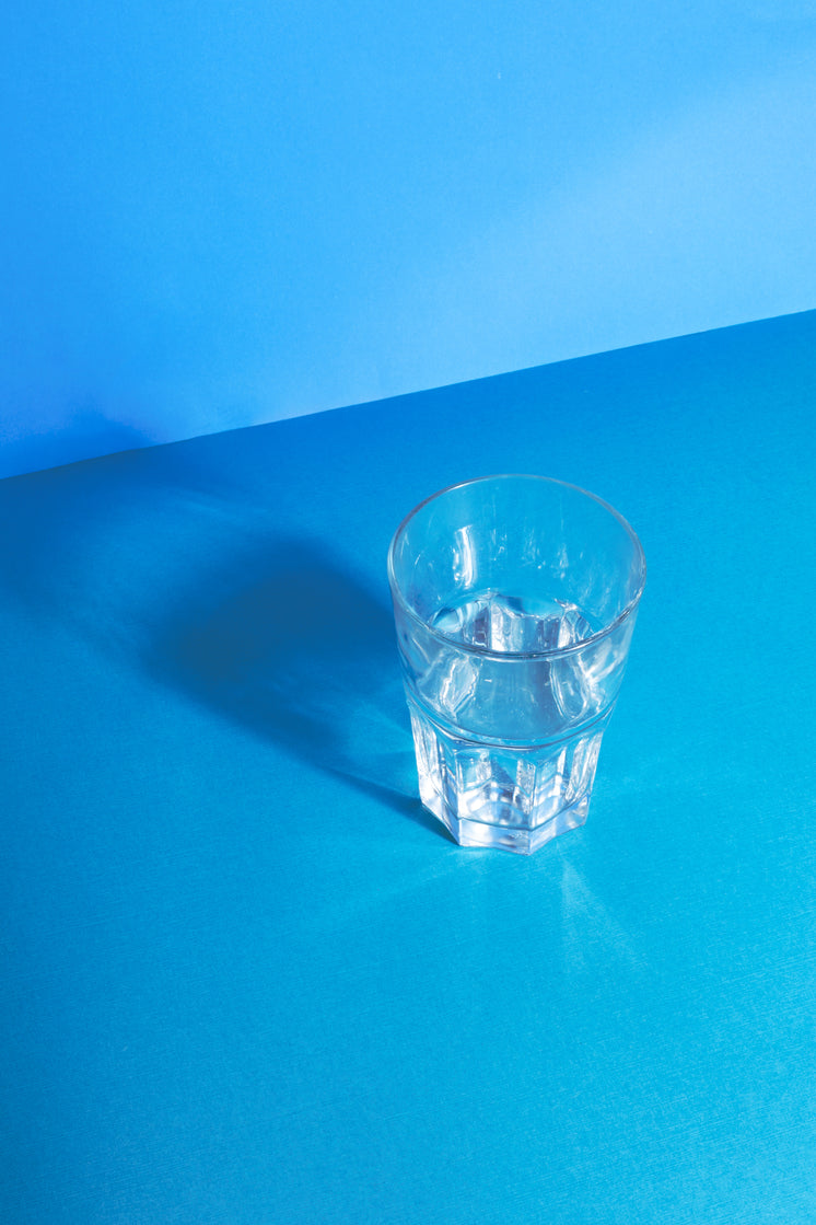Clear Water Glass Reflecting On Blue