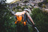 climber rappelling a mountain