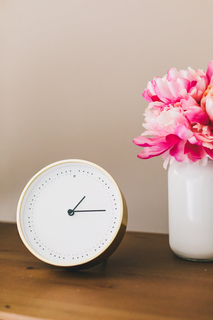Clock And Flowers On Side Table