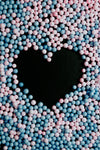 close up blue and pink balls create a heart