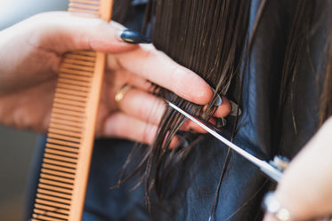 close up hands trimming hair