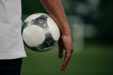 close up holding soccer ball