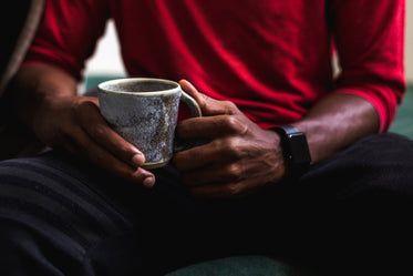 close up man holding coffee cup