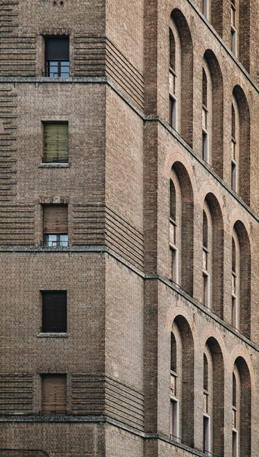 close up of a brown brick building with windows