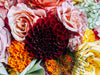 close up of a floral arrangement with a variety of flowers