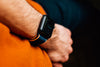 close up of a person arm wearing a smartwatch