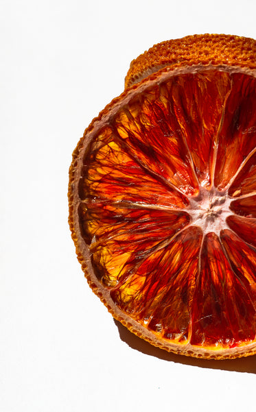 close up of a slice of orange against white