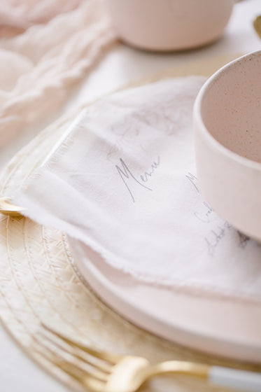 close up of calligraphy on white fabric