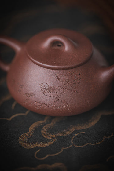 close up of chinese terracotta teapot