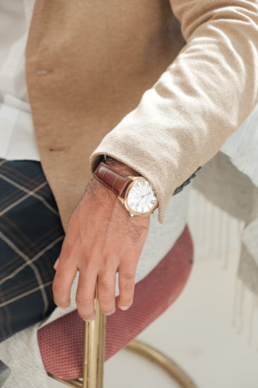 close up of classic gold and leather watch