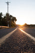 Browse Free HD Images of Close Up Of Country Road As The Sun Rises