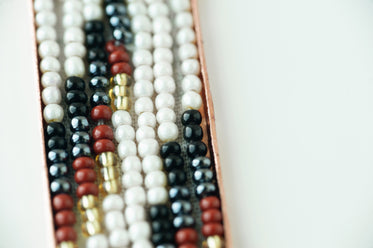 close up of different colored beads on white background