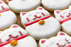 close up of lucky cat cookies