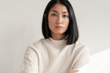 close up of model wearing cream sweater