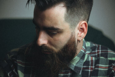 close up of person in plaid looking down