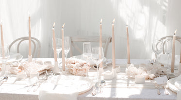 close up of pink and white wedding table setting