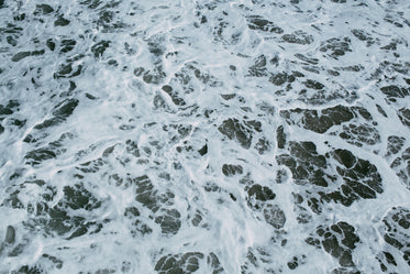 close up of the water coming into shore