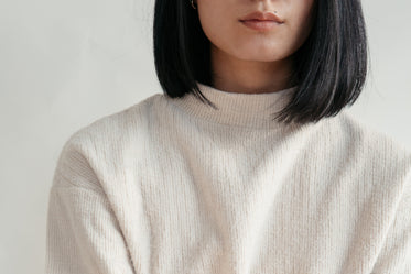 close up showing detail of cream sweater