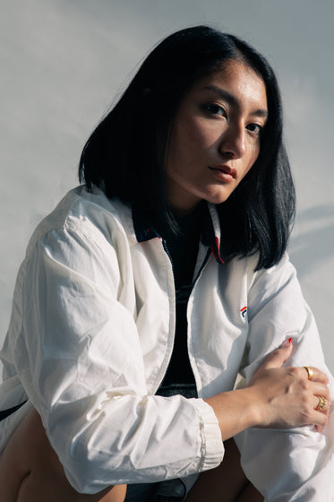 close up woman posing in white casual jacket