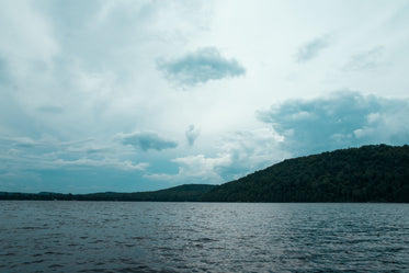 clouded sky over lake