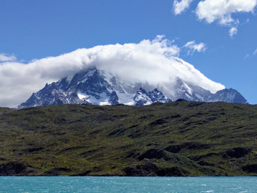 clouds around snowy mountain top