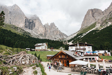 clouds drift over mountains above a valley town