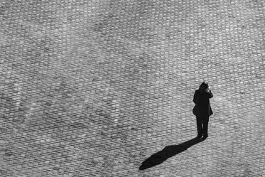 cobblestone and person with shadow