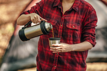 coffee being poured in front of tent