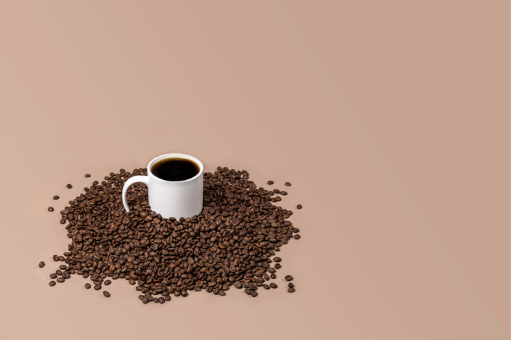 Coffee Cup Full In Beans