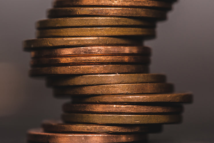 Coins Stacked In Crooked Pile