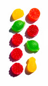 colorful candy in two rows on a white surface