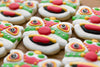 colorful cookies with red white and green icing