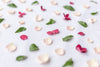 colorful flower petals on a white sheet