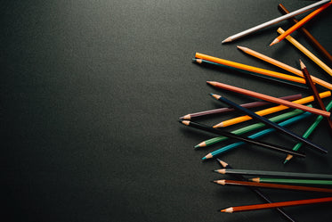 colorful pencil crayons on black background