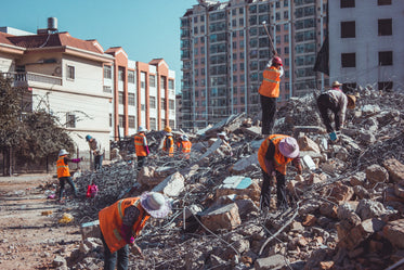 contruction workers on demolished building