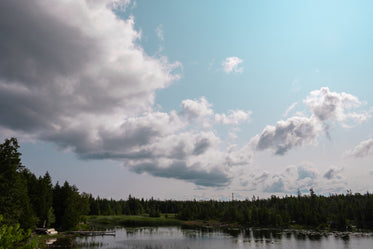 cottage lake cloudy sky