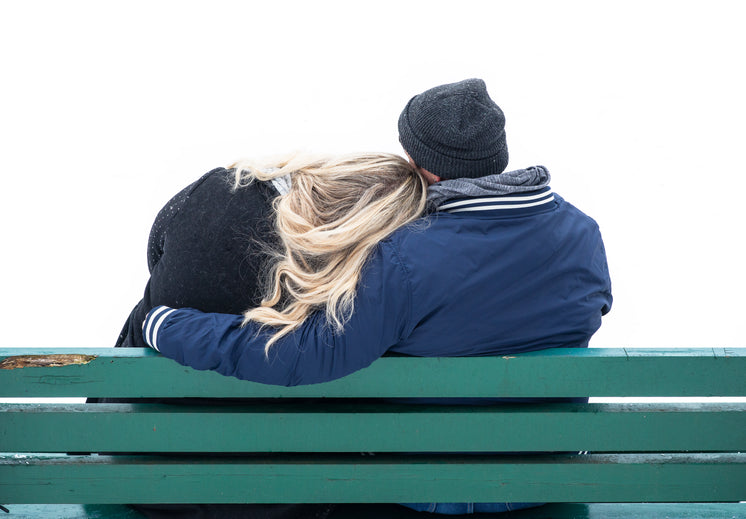 Couple Cuddles On A Park Bench